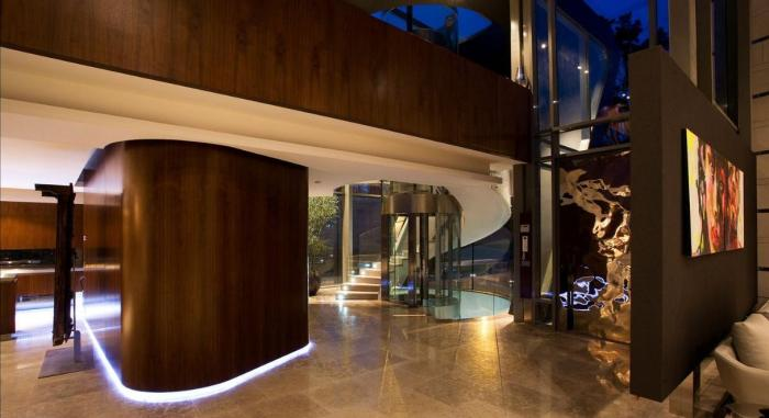 luxury-modern-house-design-interior-with-floating-room-divider-modern-cylinder-glass-residential-or-home-elevator-space-saving-twisted-fireplace-artistic-wall-painting-design-ideas
